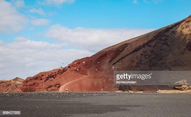 scenic view of desert against sky - bortes photos et images de collection