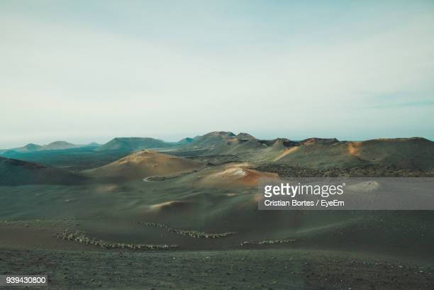 scenic view of desert against sky - bortes ストックフォトと画像