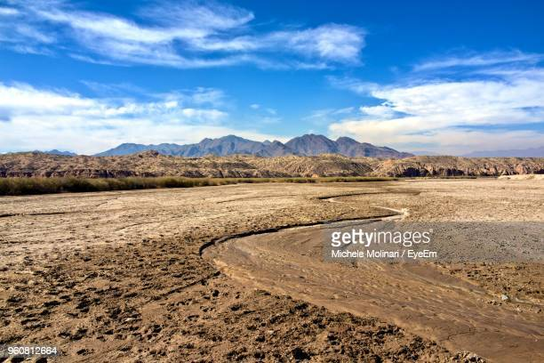 scenic view of desert against sky - mud stock pictures, royalty-free photos & images
