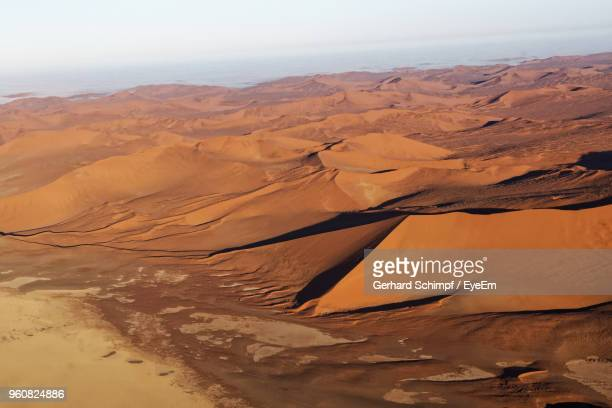 scenic view of desert against sky - gerhard schimpf stock pictures, royalty-free photos & images