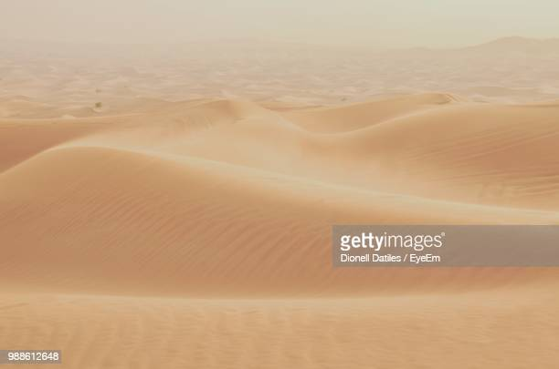 scenic view of desert against sky - wide stock pictures, royalty-free photos & images
