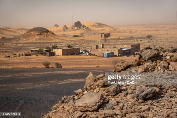scenic view of desert land against sky - sudan stock pictures, royalty-free photos & images