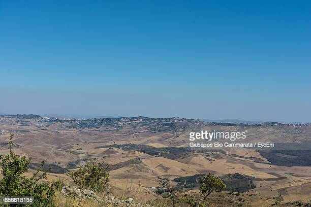 scenic view of desert landscape against clear sky - cammarata stock photos and pictures