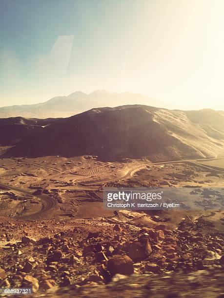 Scenic View Of Desert Landscape Against Sky On Sunny Day