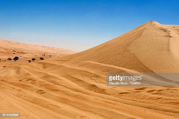 Scenic View Of Desert Landscape Against Sky