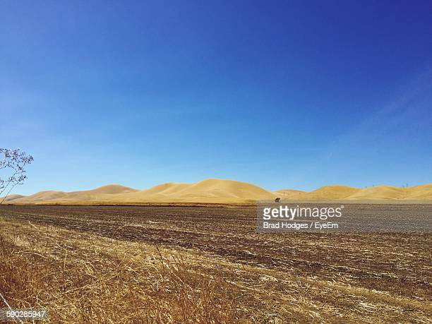 Scenic View Of Dessert Against Clear Blue Sky