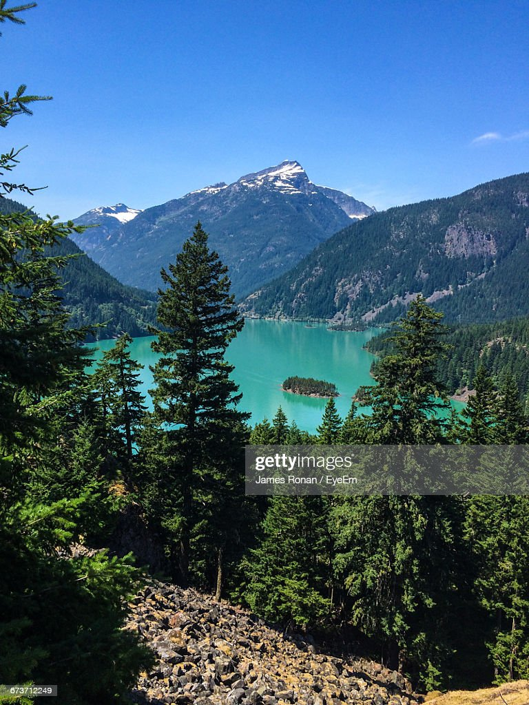 Scenic View Of Diablo Lake Amidst Mountains At North Cascades National Park : Stock Photo
