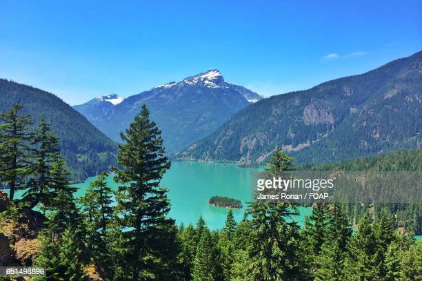 scenic view of diablo lake and mountains - diablo lake stock photos and pictures