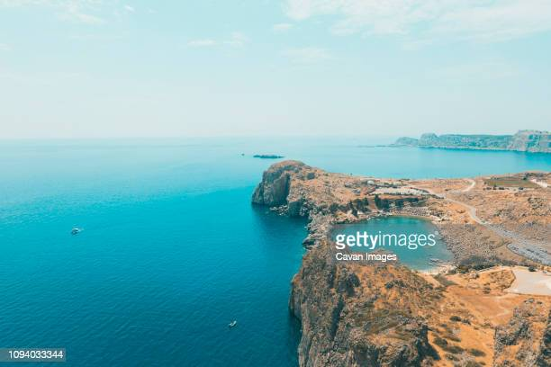 scenic view of dodecanese islands against sky during sunny day - isole del dodecanneso foto e immagini stock