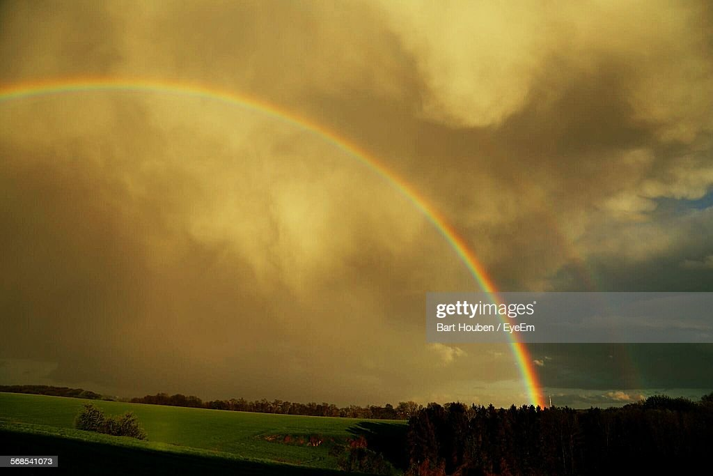 Scenic View Of Double Rainbow Against Mammatus Clouds : Stock Photo