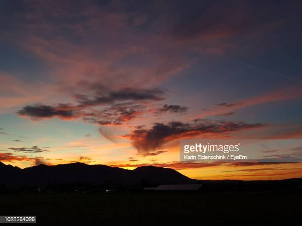 scenic view of dramatic sky during sunset - karin eidenschink stock-fotos und bilder