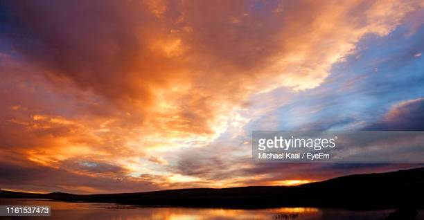 scenic view of dramatic sky during sunset - kaal stock pictures, royalty-free photos & images