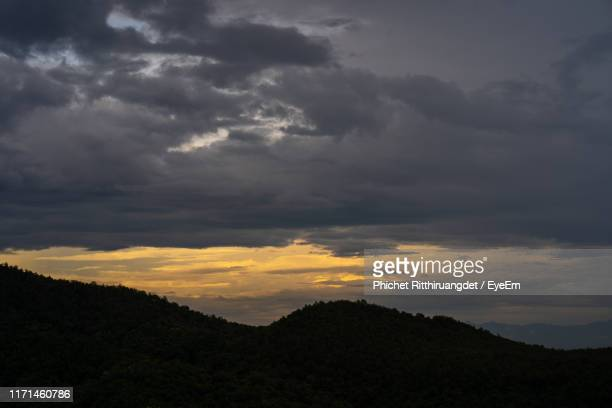 scenic view of dramatic sky during sunset - phichet ritthiruangdet stock photos and pictures