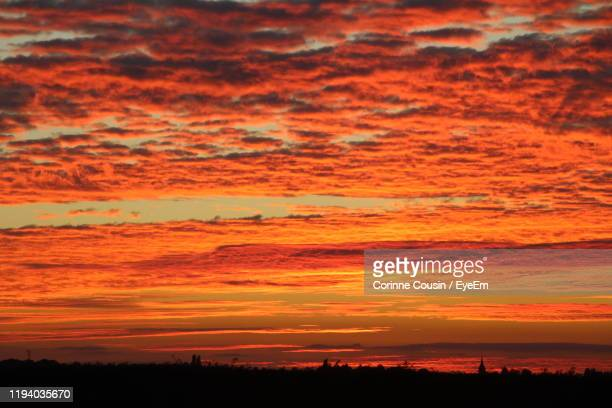 scenic view of dramatic sky during sunset - corinne paradis photos et images de collection