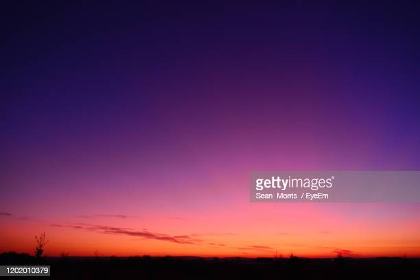 scenic view of dramatic sky during sunset - dusk stock pictures, royalty-free photos & images