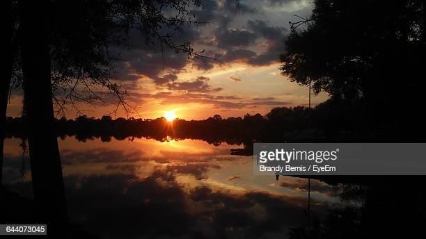 scenic view of dramatic sky over lake - sebring stock photos and pictures