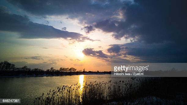 Scenic View Of Dramatic Sky Over Lake