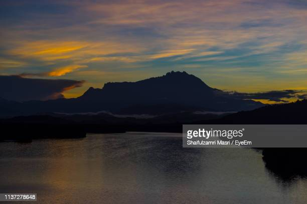 Scenic View Of Dramatic Sky Over Mountains During Sunset