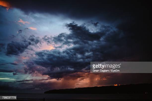Scenic View Of Dramatic Sky Over Sea At Dusk