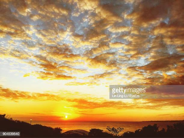 Scenic View Of Dramatic Sky Over Sea During Sunset