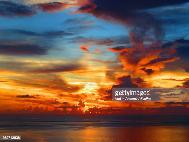 scenic view of dramatic sky over sea during sunset - antonov stock pictures, royalty-free photos & images
