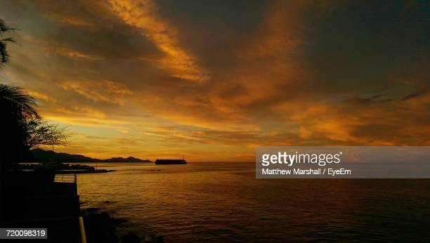 scenic view of dramatic sky over sea - honiara stock pictures, royalty-free photos & images