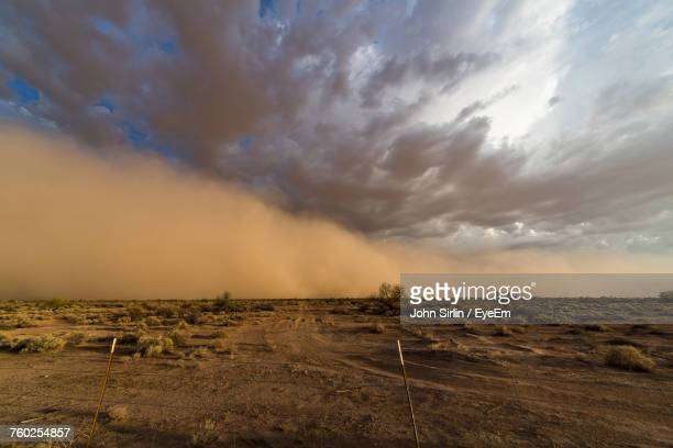 scenic view of dust storm over desert against sky during sunset - dust storm stock pictures, royalty-free photos & images