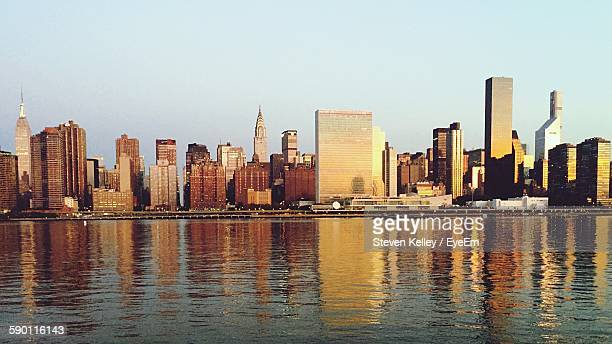 Scenic View Of East River By Cityscape Against Sky