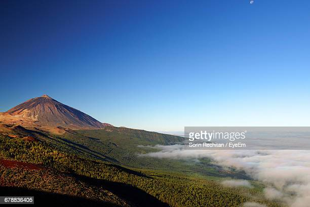 scenic view of el teide volcano against blue sky - el teide national park stock pictures, royalty-free photos & images