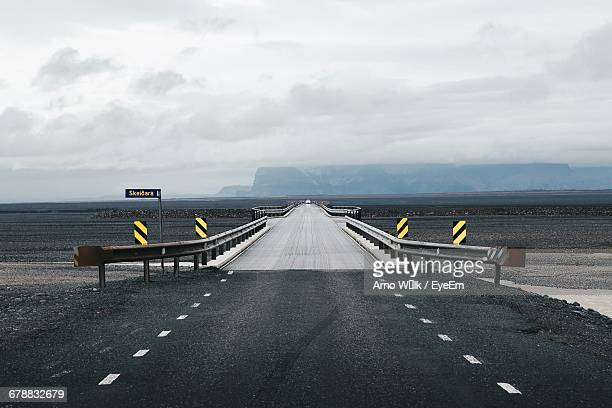 Scenic View Of Empty Road In Remote Landscape