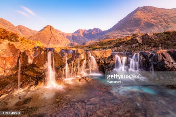 scenic view of fairy pools waterfall, glenbrittle, isle of skye, highlands, scotland, uk - beauty stock pictures, royalty-free photos & images