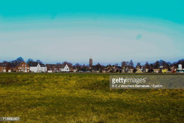 scenic view of farm against sky - breda stock pictures, royalty-free photos & images