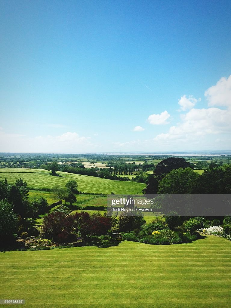 Scenic View Of Farms Against Blue Sky : Stock Photo