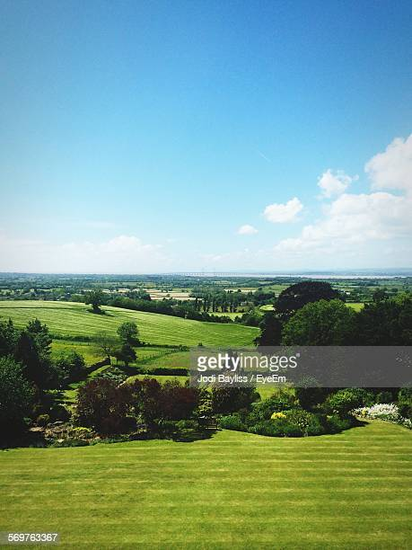 scenic view of farms against blue sky - bedfordshire stock photos and pictures