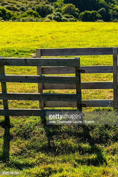 Scenic View Of Fenced Grassy Field