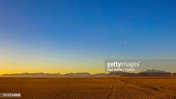 scenic view of field against clear blue sky - keiffer ストックフォトと画像