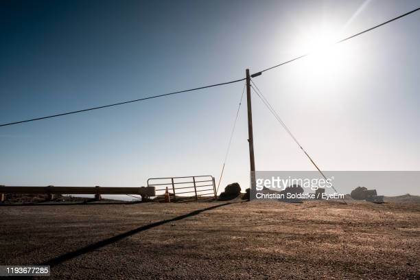 scenic view of field against clear sky during sunset - christian soldatke stock pictures, royalty-free photos & images