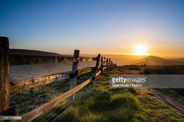 scenic view of field against clear sky during sunset - england stock pictures, royalty-free photos & images