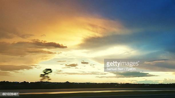 scenic view of field against cloudy sky during sunset - barr stock pictures, royalty-free photos & images