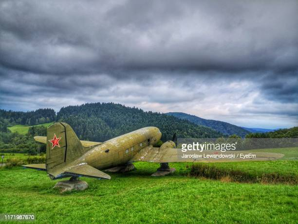 scenic view of field against cloudy sky - lewandowski stock photos and pictures