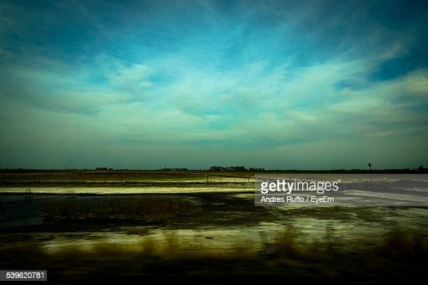 scenic view of field against sky at dusk - andres ruffo stock pictures, royalty-free photos & images