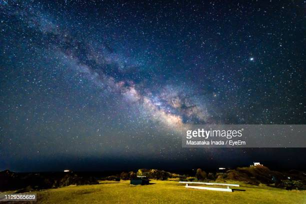 scenic view of field against sky at night - 千葉市 ストックフォトと画像