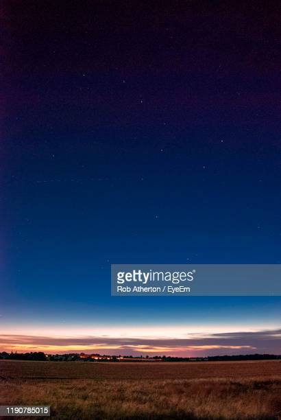 scenic view of field against sky at night - sky stock pictures, royalty-free photos & images