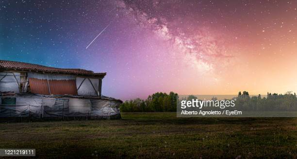 scenic view of field against sky at night - treviso italy stock pictures, royalty-free photos & images