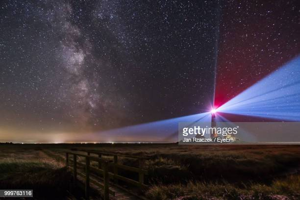 scenic view of field against sky at night - schleswig holstein stock pictures, royalty-free photos & images