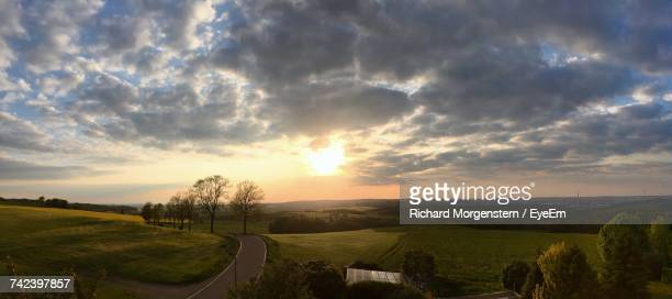 scenic view of field against sky at sunset - chemnitz stock pictures, royalty-free photos & images