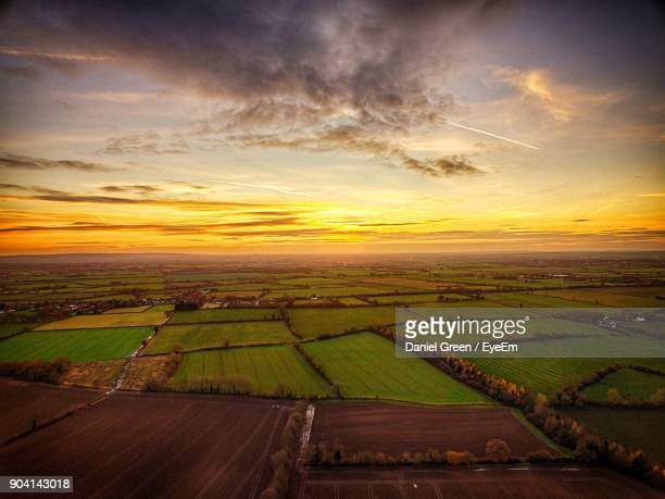 scenic view of field against sky at sunset - aylesbury stock photos and pictures