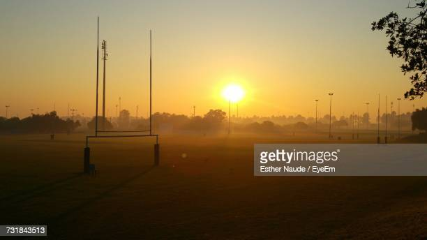 scenic view of field against sky during sunrise - rugby pitch stock pictures, royalty-free photos & images