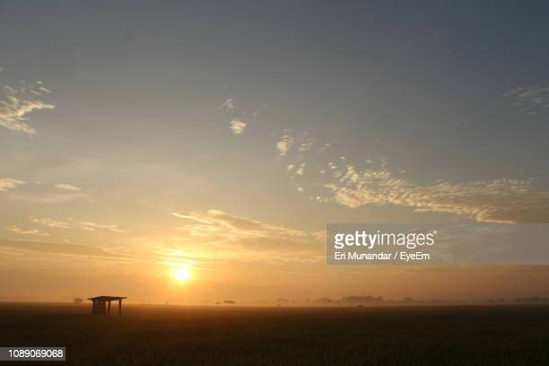 scenic view of field against sky during sunset - munandar stock pictures, royalty-free photos & images