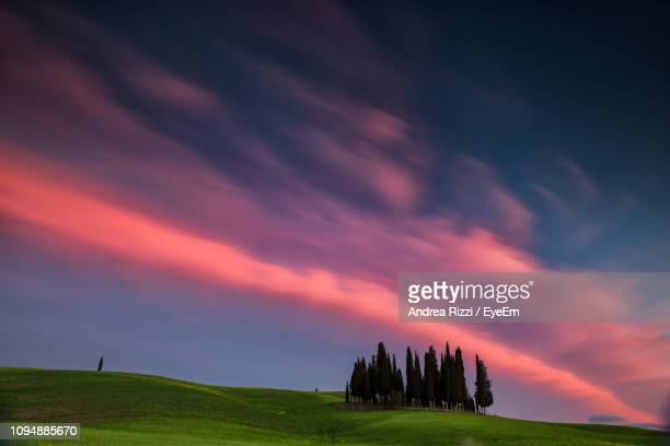 scenic view of field against sky during sunset - andrea rizzi stock pictures, royalty-free photos & images
